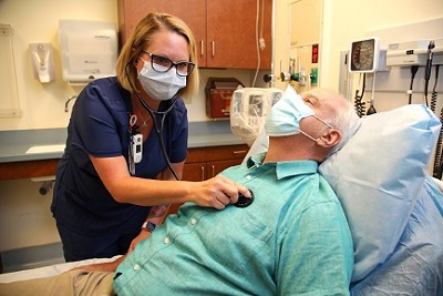 Doctor checking Veteran's heart rate